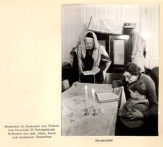 Warsaw Ghetto, Poland, A man, woman and child praying in the ghetto