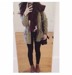 Cold weather outfit. Black pants / leggings, white tee shirt, burgundy knit scarf, green parka, with matching brown belt and shoes.