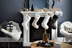 Luxe holiday decor—When it comes to holiday decorating, lush fabrics, warm accents and a moody palette keep things cozy. Dinosaur Toys, Learn How To Knit, Christmas Stockings, Entryway Tables, Things To Come, Home And Garden, Tutorial, Holiday Decorating, Ideas Para