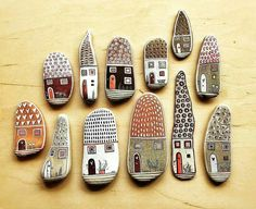 Painted pebble art houses More