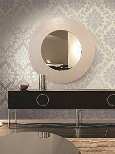 an accent wall of metallic grey damask wallpaper