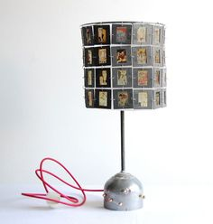 """Lamp shade made of """"slides"""".  Would be neat with family slides.  When the light is turned on they show through."""