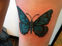 My own butterfly tattoo.  This photograph was taken the moment the tattoo was finished and so it's still 'wet'.