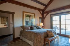 Master Bedroom with Exposed Wood Beams