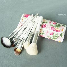 Price:$26.99 Color: White/Pink Material: Wool Elegant 12pcs Beauty Makeup Brushes Set Kit with Floral Print Bag