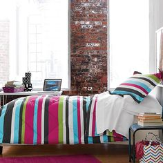 This cozy down-free comforter adds just the right splash of color to her dorm room. Designed with variegated stripes in a chic, contemporary...