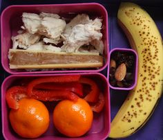 Paleo lunchbox idea: Leftover slow cooked chicken, almond butter in a celery stick, trail mix, banana, clementine oranges, and cut up red peppers
