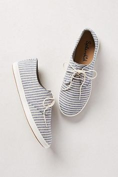 White and blue striped sneakers.