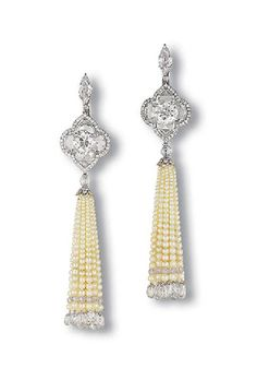 A PAIR OF CHARMING PEARL AND DIAMOND EAR PENDANTS, BY BHAGAT Each designed as a seed pearl tassel, terminated by diamond beads and briolette diamonds, suspended from a diamond bead and brilliant-cut diamond quatrefoil link, to the old and vari-shaped rose-cut diamond plaque, with a pear-shaped diamond surmount, mounted in platinum, 9.5 cm long Signed Bhagat