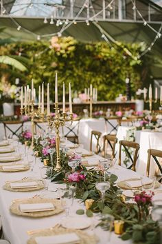Garden-Inspired Michigan Wedding, Long Tables with Greenery Garlands and Tall Candles | Brides.com