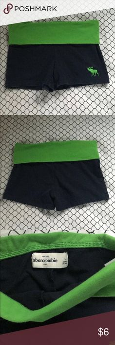 Abercrombie kids yoga shorts This is a pair of navy blue yoga shorts with a green band and Abercrombie logo for kids. abercrombie kids Bottoms Shorts