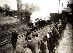 Staff from John Sanders Ltd line the railway embankment to pay their last respects to King George V as his body is transported to Windsor on a GWR train - UK - 23 January 1936