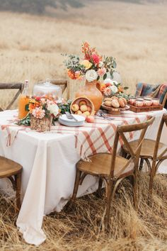 a chic and bright Thanksgiving table with bright florals, white pumpkins in cloches and a plaid tablecloth Fall Home Decor, Autumn Home, Autumn Fall, Harvest Party, Welcome Fall, Fall Dinner, Dinner Table, White Pumpkins, Fall Table
