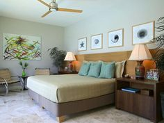 A slight theme in a bedroom can make you feel as if your on vacation. Check out the beachy feeling of this bedroom.