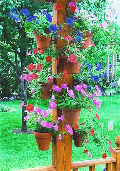 This is a great idea to hang clay pots of petunias the colors are awesome!