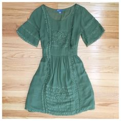 """Green Dil Dress Beautiful green dress by the brand Dil. Purchased from Anthropologie. Zips up the side and has a separate green slip (100% polyester). I love all of the lace trim, rosettes, and other details on this dress! 100% silk. Size 6. Approx. 17"""" bust, 14"""" waist, 37"""" long (shoulder to hem). NWOT - never worn and in perfect condition! No PP, trades or holds. Happy poshing!  Anthropologie Dresses"""