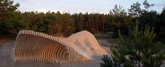 the cross laminated timber structure is an abstraction of the formation of a sand dune over a period of time.