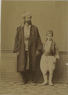 Turkish Father and Son in traditional clothing, Ottoman Empire 1880s.