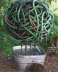 Recycle your old hoses into a hose topiary!