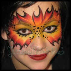 Hunger Games Face Painting by Manja Warner, Shining Faces.  Girl on Fire Mask.