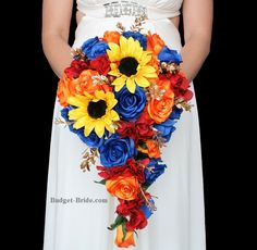 Fall Wedding Bouquet teardrop shape with red, orange and blue flowers with sunflowers