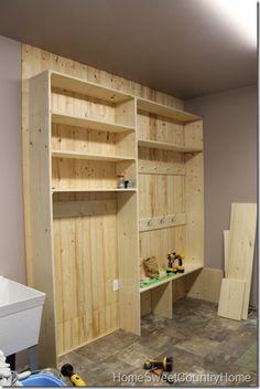 DIY Shelves, coat racks, and bench for the garage/mud room.