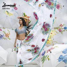 This pure white color saree is glistering with contrast pashmina silk blouse & sparkle work on the floral prints.
