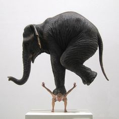 Wonder if it could possibly be real? Fabien Mérelle's complex works are small and he pays close attention to detail, two qualities that can be seen in this particular work, entitled Pentateuque. The piece is a whimsical sculpture that depicts a man, balancing the weight of an elephant on his back. It is made out of resin, paint, hair and fabric, and stands only 30 x 27 x 12 inches.