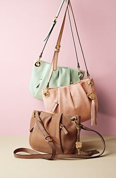 Mint, pink & camel Vince Camuto cross body bags.