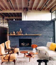 slate blue fireplace wall. warm midcentury living room.
