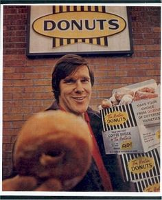 Former Maple Leaf defenceman Tim Horton offering you a donut, outside one of his coffee shops he first opened in when he was still playing. There are now Tim Hortons across Canada. Canadian Things, I Am Canadian, Canadian History, Canadian Facts, Canadian Cuisine, Timmy Time, Hamilton Ontario, Tim Hortons, Canada Eh