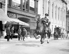 Mounted cop flies down Tremont Street, Boston 1920s - Photo by Leslie Jones