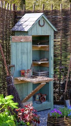 Cute Potting Shed.... From an old outhouse or a shed designed like an old out house! I think this might work to keep the vegetable garden tools in!