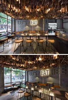 This contemporary restaurant has an artistic ceiling detail made from hundreds of wood veneer sheets.