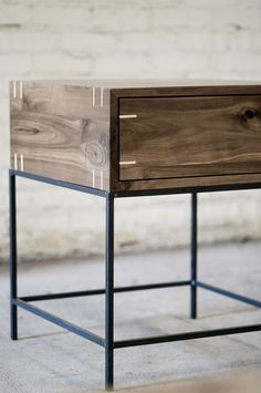 Myers end table in Walnut with Maple splines and blackened steel base by kith&kin