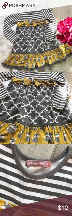 {•Jelly The Pug Dress•} Cute boutique dress! Jelly the Pug brand. Size 6. Reposh! My daughter did wear it 2-3 times but it didn't fit her well. She's tall and skinny- the length was too short- body too big. Size 6. Long sleeves. Cute mustard yellow and gray in color. Fox print and stripes. Bow is coming a little loose, but not bad- noted in pics. Overall still in great shape. Has very mild fading from being washed etc. From a clean and smoke free home. {Posh Ambassador  {200+ Sales Jelly The…