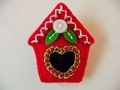 This cute little felt birdhouse is made of bright holiday red felt, and it will look great perched on the collar or lapel of your holiday outfits