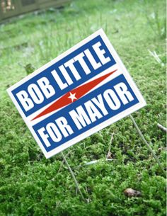 miniature yard sign for a dollhouse or Christmas village