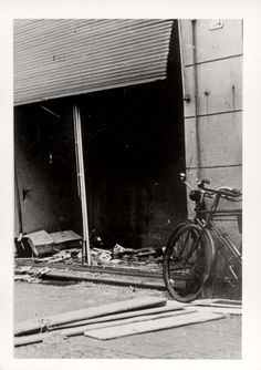 Munster, Germany, a shattered display window of a Jewish store, after Kristallnacht.