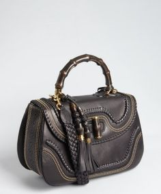 Gucci : I'm craving a bag with tassels