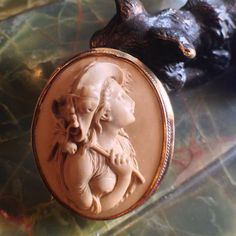 """Antique 14kt lava cameo brooch of a young girl posing with a riding crop measuring 1-3/4"""" wide and 1-7/8"""" long circa 1870-80s #antiquebrooch#lavacameo#antiquelavacameo#lavacameobrooch#victoriancameo#victorianbrooch#ridingcrop#victorianhorsewoman#shopoldtownalexandriava#alexandriava#theantiqueguildalexandriava#oldtownalexandria#oldtownalexandriava"""