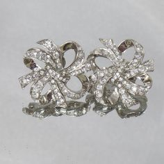These #vintage KJL clear rhinestone earrings are simply stunning.  They feature ribbons and bows in silver filled with sparkling clear rhinestones.  Perfect for the holidays... #ecochic #etsy #jewelry #jewellery