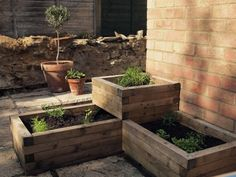 Stacked tiered raised garden beds; Gardenista - If you stack raised garden beds, you can grow different sorts of plants on each tier. Reserve the top tier for vines and climbers that like to spill over the side. Or put scented plants at nose level.