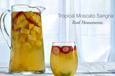 Tropical Moscato Sangria is so easy to make and a real crowd-pleaser. The perfect party drink! You mix it up the day before & no one has to play bartender! Party Drinks, Cocktail Drinks, Fun Drinks, Beverages, Cocktails, Healthy Drinks, Moscato Sangria, Jello Shots, Daisies