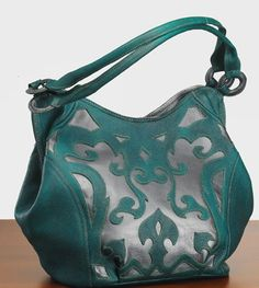 Turquoise Totes: Hand-tooled turquoise on gunmetal purse