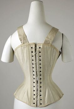 Corset Date: 1890s Culture: American Medium: cotton, boning, metal Dimensions: Length at CB: 14 in. (35.6 cm)