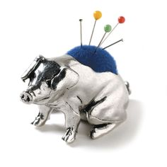 Pewter pig pincushion. I want this one from Carol Ahles Fine Heirloom Tools.
