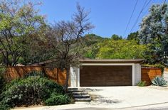 Built in 1959, this classic mid-century in the Laurel Hills section of the Hollywood Hills has it all–gorgeous walls of glass, wood beamed ceilings, bamboo floors, fireplace and more.