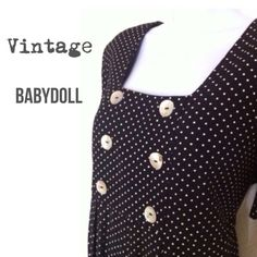 """Vintage Babydoll Dress Black & White polka dot vintage dress by Larisa New York. Pretty shell buttons, shoulder-pads for a great silhouette, baby doll style with umpire waist, wide body with an adjustable back sash. Long 48"""" inches from shoulder to hem. Adorable.  Larisa New York Dresses"""