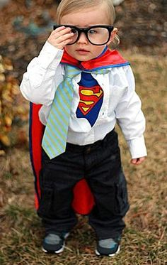 "Clark Kent/ Superboy costume. This is super adorable on this little guy, but would actually be pretty easy to pull off for an adult too. Superman tshirt, white button down, slacks, tie, glasses. Cape optional. For a couple, she could go as Lois Lane - suit or ""biz casual"" outfit, notepad, maybe a press pass."